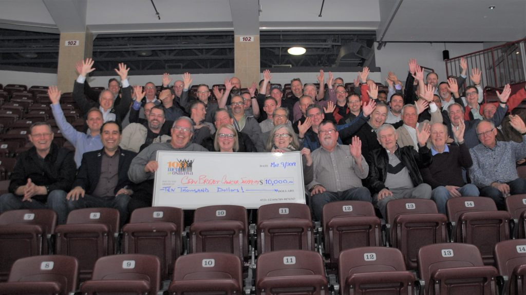 100 Men and $10,000 cheque